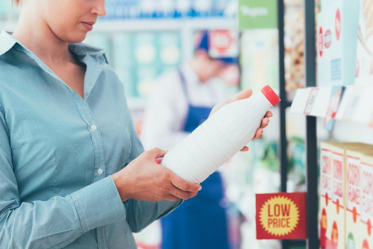 a woman reading labels in the grocery store